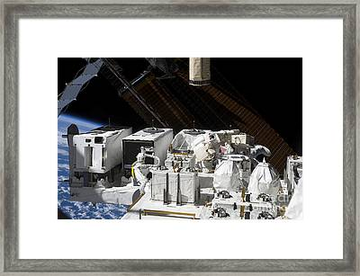 Astronaut Working On The Japanese Framed Print by Stocktrek Images
