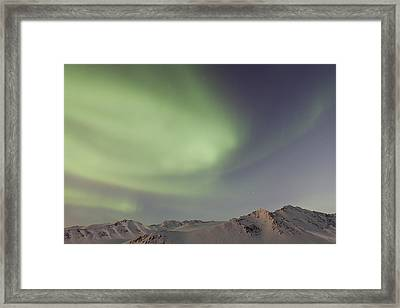 Auroras Over Mountains Framed Print by Tim Grams