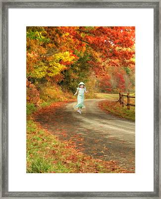 Autumn Play Framed Print by Darren Fisher