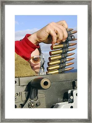 Aviation Ordnanceman Reloads Framed Print by Stocktrek Images