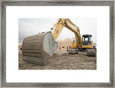 Backhoe On Construction Site Framed Print by Shannon Fagan