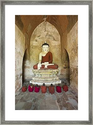 Bagan, Buddhist Monks Sitting In Temple Framed Print by Martin Puddy