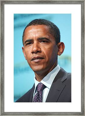 Barack Obama On Stage For Democratic Framed Print by Everett