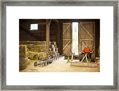 Barn With Hay Bales And Farm Equipment Framed Print by Elena Elisseeva