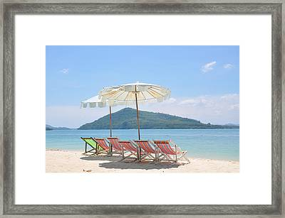 Beach Chair And Umbrella On Beach Framed Print by Eustaquio Santimano