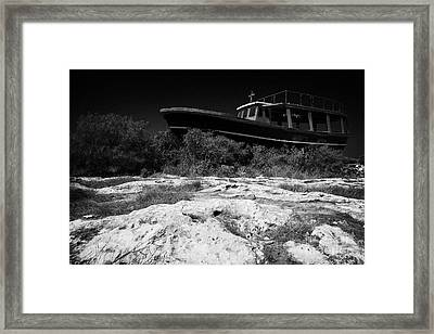 Beached Abandoned Fishing Boat In Potamos Typical Small Unspoilt Fishing Village Cyprus Framed Print by Joe Fox