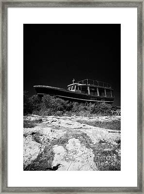 Beached Abandoned Fishing Boat In Potamos Typical Small Unspoilt Fishing Village Republic Of Cyprus Framed Print by Joe Fox
