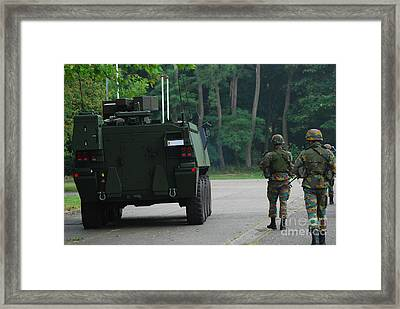 Belgian Infantry Soldiers Walk Framed Print by Luc De Jaeger