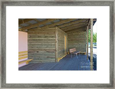 Benches On The Porch Of An Elementary School Framed Print by Jaak Nilson