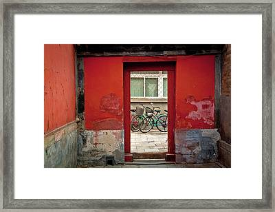Bicycles In Red Doorway Framed Print by photo by Sharon Drummond
