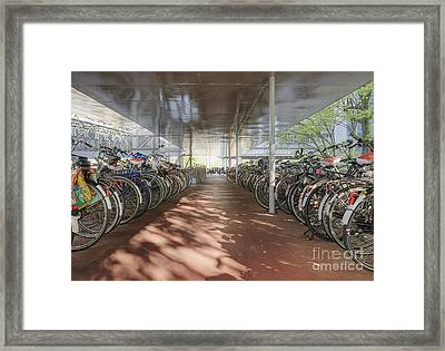 Bicycles Under A Shelter Framed Print by Andersen Ross