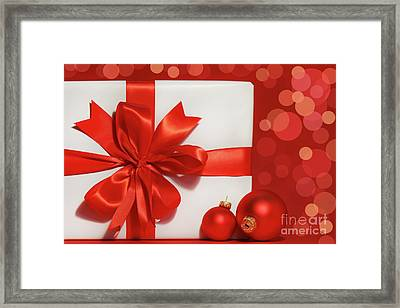 Big Red Bow On Gift  Framed Print by Sandra Cunningham
