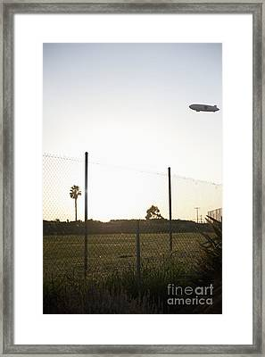 Blimp Flying Over Sports Field Framed Print by Sam Bloomberg-rissman