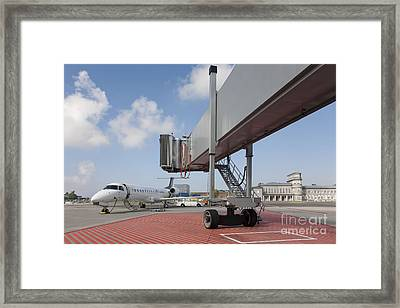 Boarding Bridge Leading To A Parked Plane Framed Print by Jaak Nilson