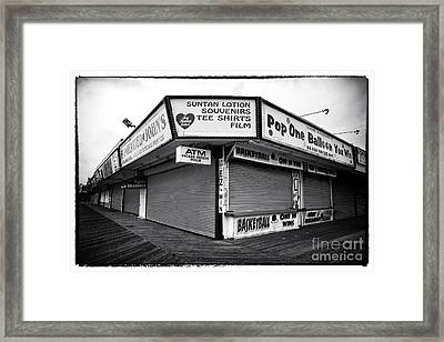 Boardwalk Shopping Framed Print by John Rizzuto