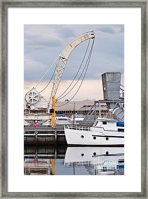 Boat And Old Crane Reflections Framed Print by David Lade