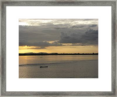 Boat On River At Sunset Framed Print by Nawarat Namphon