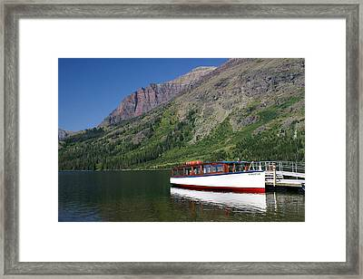Boat On Two Medicine Framed Print by Marty Koch