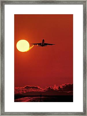 Boeing 747 Taking Off At Sunset Framed Print by David Nunuk