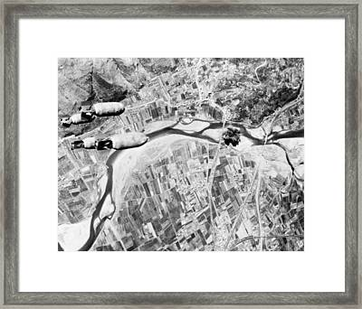 Bombs Hurtle Toward A Nazi Highway Framed Print by Everett
