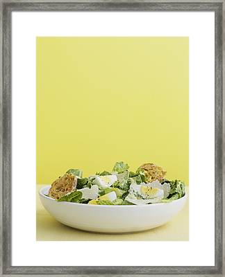 Bowl Of Caesar Salad With Egg Framed Print by Cultura/BRETT STEVENS