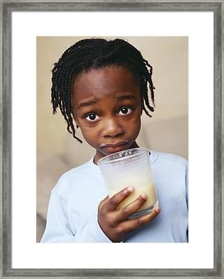 Boy Drinking Milk Framed Print by Ian Boddy