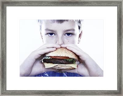 Boy Eating A Burger Framed Print by Kevin Curtis