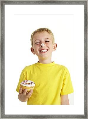 Boy Eating A Doughnut Framed Print by Ian Boddy