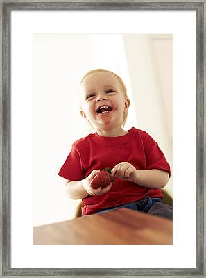 Boy Eating A Strawberry Framed Print by Ian Boddy