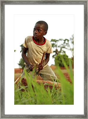 Boy Playing A Drum, Uganda Framed Print by Mauro Fermariello