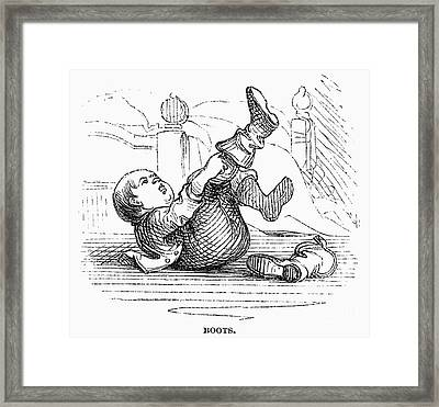 Boy Putting On Boots Framed Print by Granger