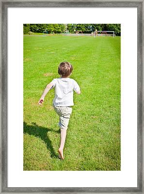Boy Running Framed Print by Tom Gowanlock