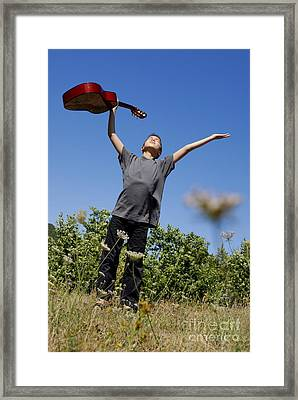 Boy Standing In Meadow With Guitar Framed Print by Sami Sarkis
