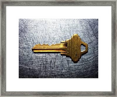 Brass Key On Stainless Steel. Framed Print by Ballyscanlon