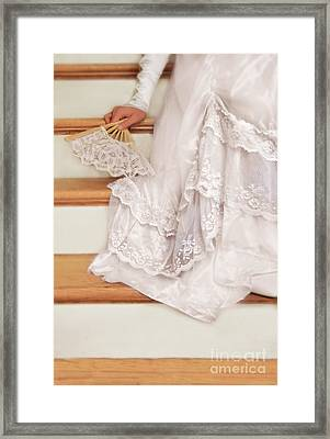 Bride Sitting On Stairs With Lace Fan Framed Print by Jill Battaglia
