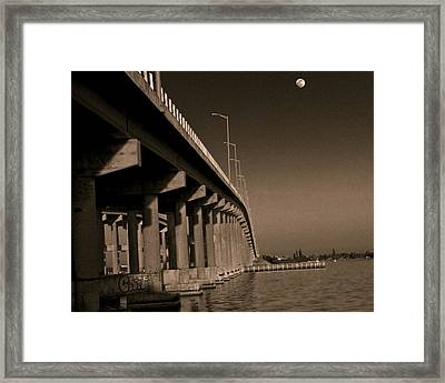 Bridge To The Moon Framed Print by Roger Wedegis