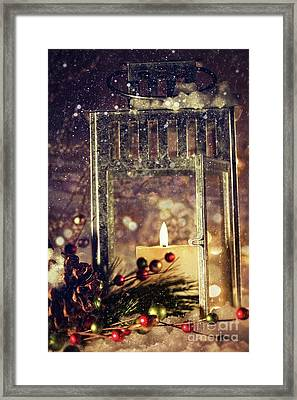 Brightly Lit Lantern In The Snow Framed Print by Sandra Cunningham