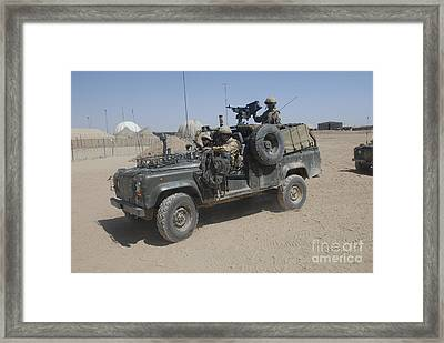British Soldiers In Their Land Rover Framed Print by Andrew Chittock