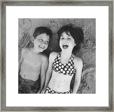 Brother And Sister On Beach Framed Print by Michelle Quance