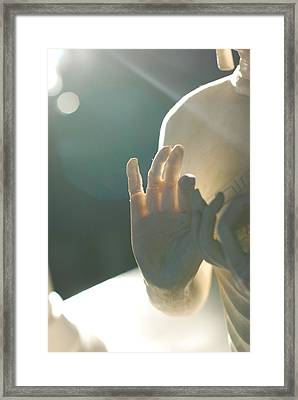 Buddha Figure's Hand Is Illuminated From Behind Framed Print by Shawna Lemay