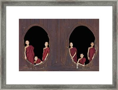 Buddhist Monks In Window Of Monastery Framed Print by Martin Puddy
