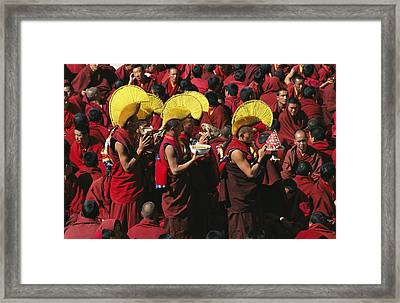Buddist Monks At Nechung Monastery Framed Print by Maria Stenzel
