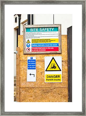 Building Site Signs Framed Print by Tom Gowanlock