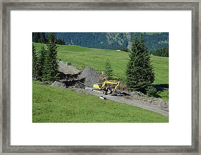 Bulldozing A New Path On A Swiss Mountain Side Framed Print by Ashish Agarwal