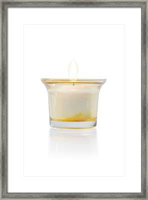 Burning Candle In Glass Holder Framed Print by Atiketta Sangasaeng