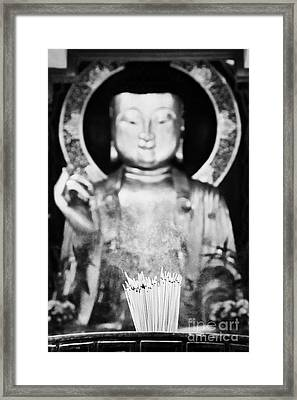 Burning Incense In A Buddhist Temple Sha Tin China Hong Kong Framed Print by Joe Fox
