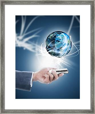 Businessman Holding Mobile Phone With Globe Framed Print by Setsiri Silapasuwanchai