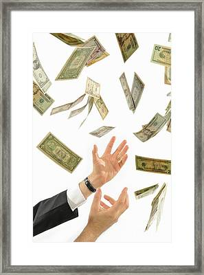 Businessman's Hands Trying To Catch Us Dollars Framed Print by Sami Sarkis