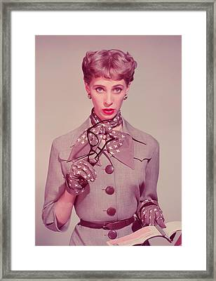 Businesswoman Holding Glasses And Chequebook, Portrait Framed Print by Hulton Archive