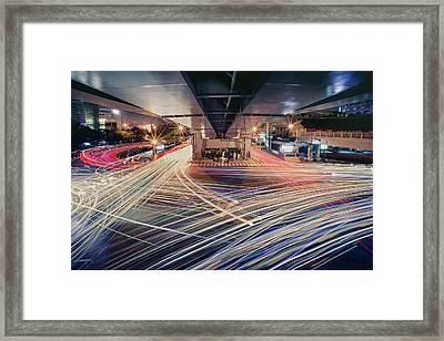 Busy Light Trail In City At Night Framed Print by Yiu Yu Hoi